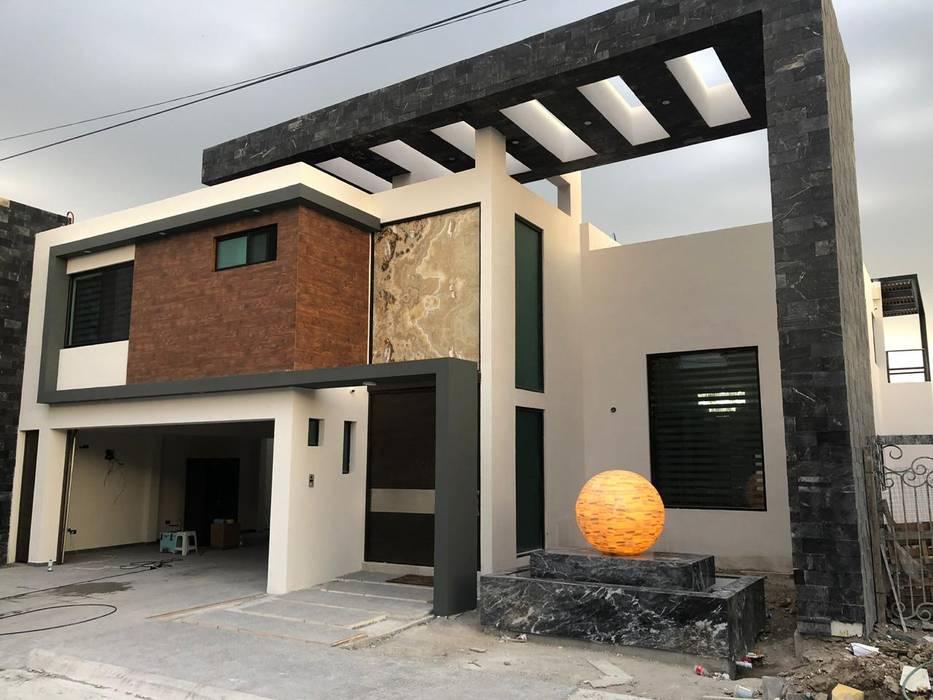 casas residencial  Zuazua Nuevo Leon: Casas multifamiliares de estilo  por Arquitecto-Villarino, Moderno