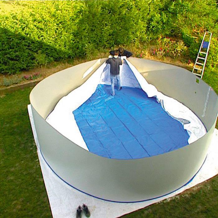 Montaje Liner en piscina de acero: Piscinas de jardín de estilo  de Outlet Piscinas,