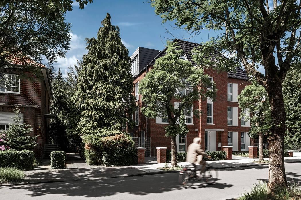 Eingepasste Straßenansicht im Traditionsviertel des Mehrfamilienhauses:  Mehrfamilienhaus von Hilger Architekten,