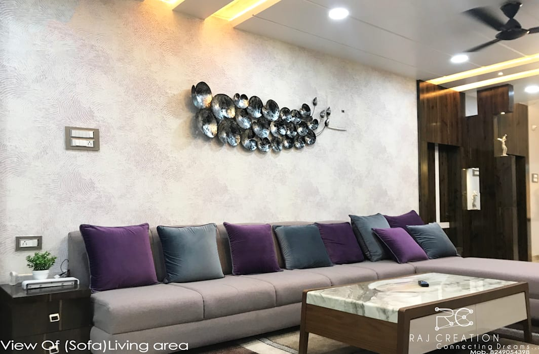 Mr. Subuddhi residency:  Living room by Raj Creation,