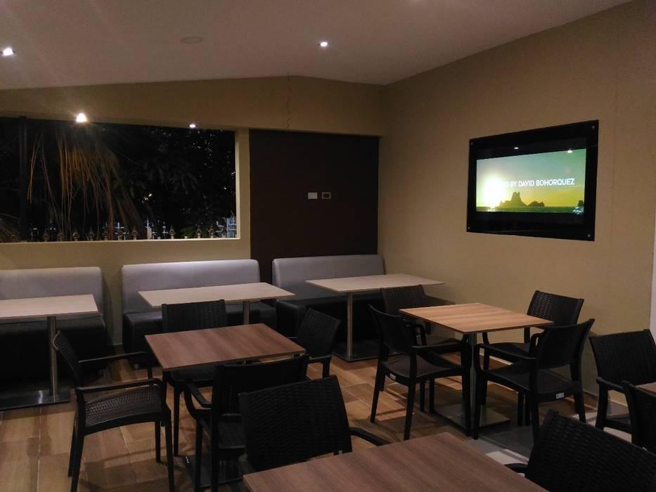 Remodelacion Interior: Espacios comerciales de estilo  por CAMALEON DISEÑOS