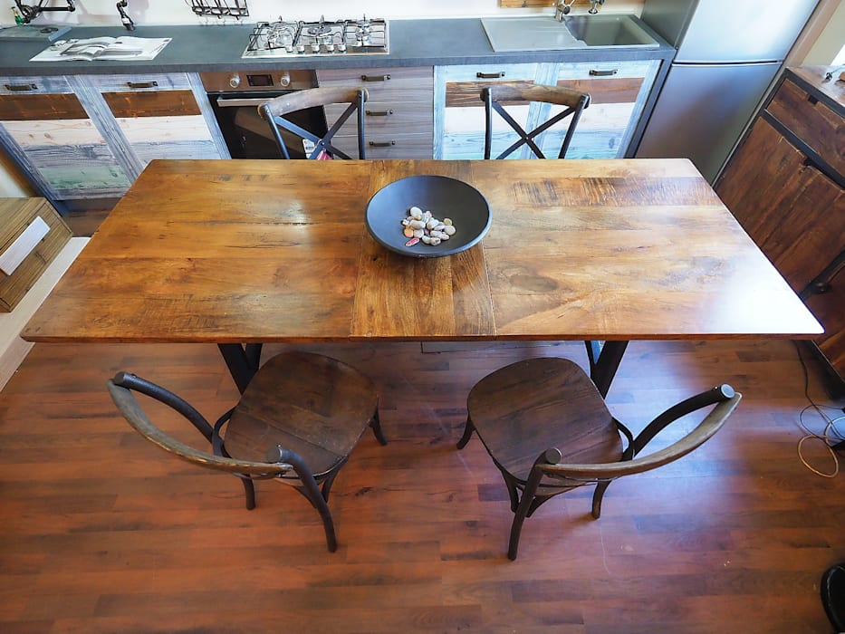Industrial style dining room by nuovimondi di Flli Unia snc Industrial