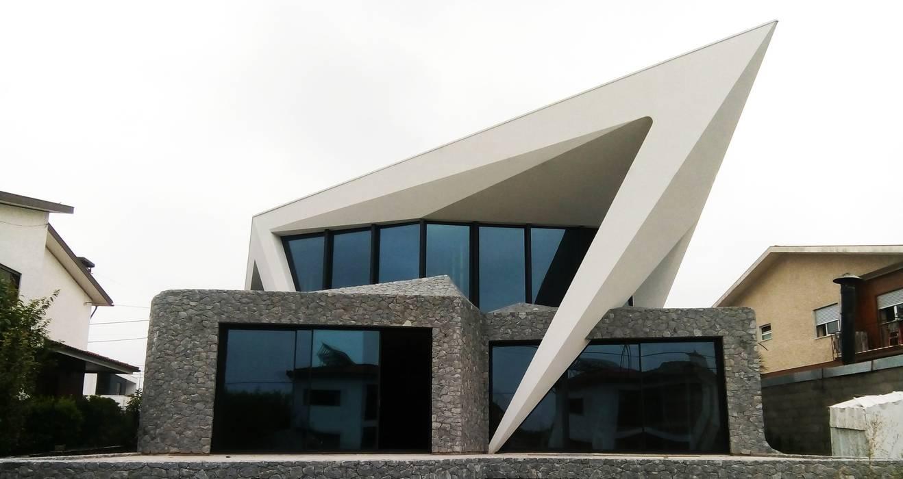 Habitação Unifamiliar Isolada T4 - o Tempo e a Sensação por Office of Feeling Architecture, Lda Moderno