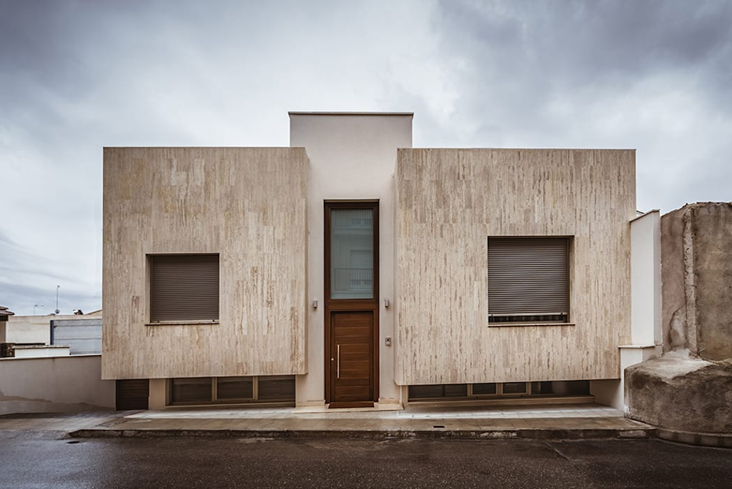 Rumah oleh OOIIO Arquitectura, Modern Batu