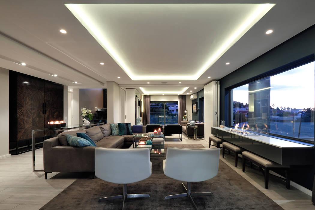 Salones de estilo moderno de KMMA architects Moderno