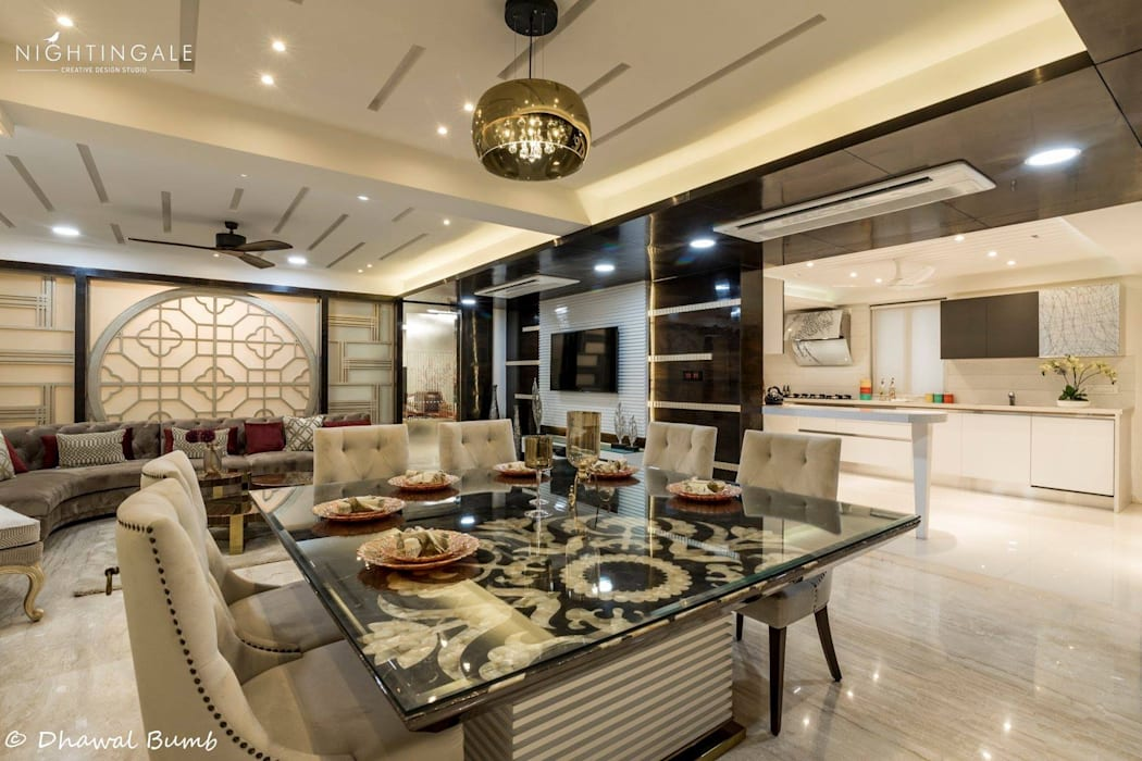 Living & Dining done so tastefully. :  Living room by Nightingale Creative Design Studio, Modern Glass