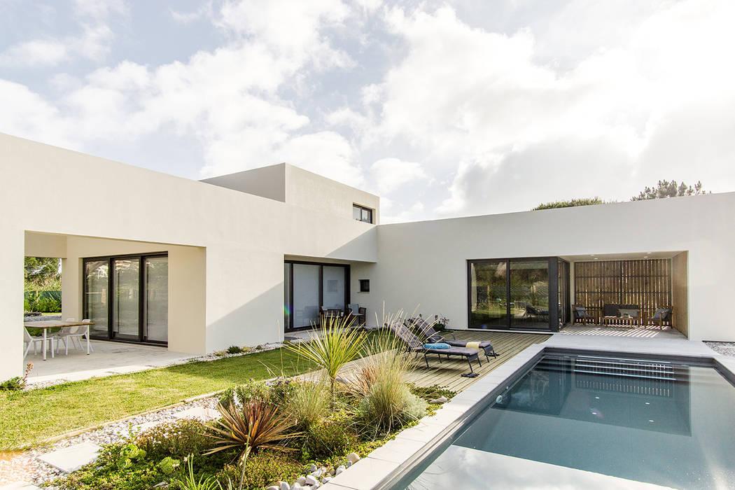 Namu House: Casas  por [i]da arquitectos,