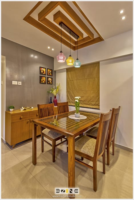 2BHK apartment in Pune :  Dining room by The D'zine Studio