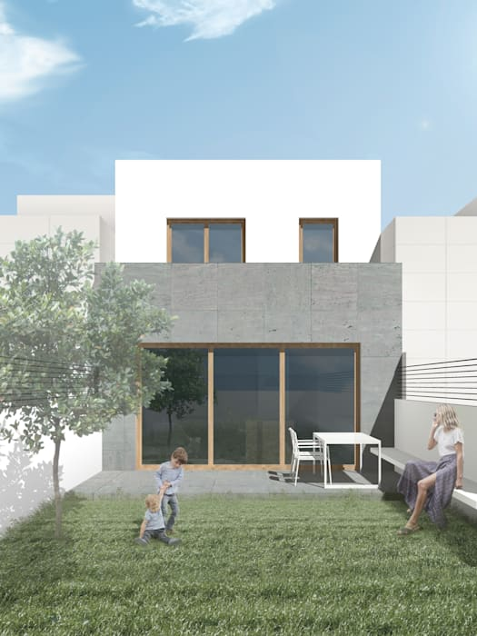 Fachada posterior a jardín de vivienda unifamiliar adosada Casas de estilo moderno de Reformmia Moderno