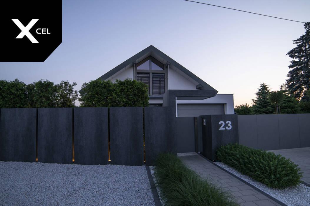 Nowoczesne ogrodzenie ze spieków kwarcowych: styl , w kategorii Podwórko zaprojektowany przez Xcel,