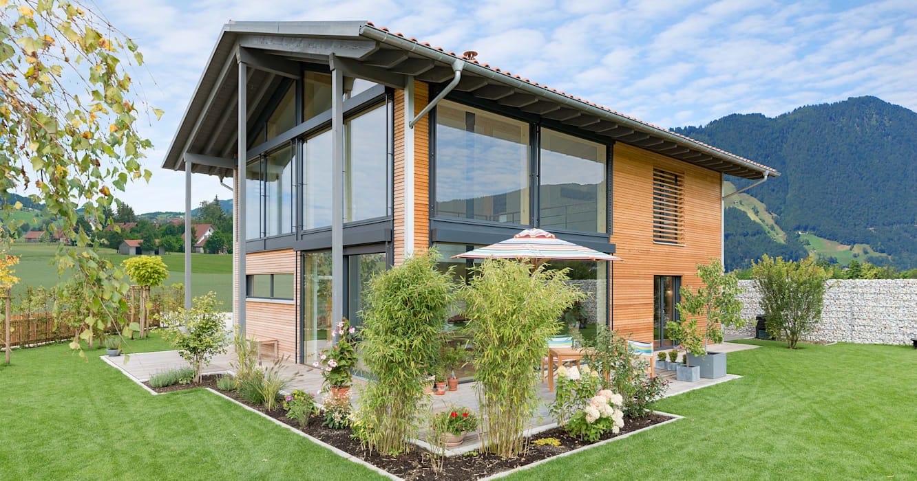 Wooden houses by Bau-Fritz GmbH & Co. KG,