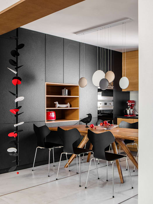 Kitchen and dining by C&M Media Modern