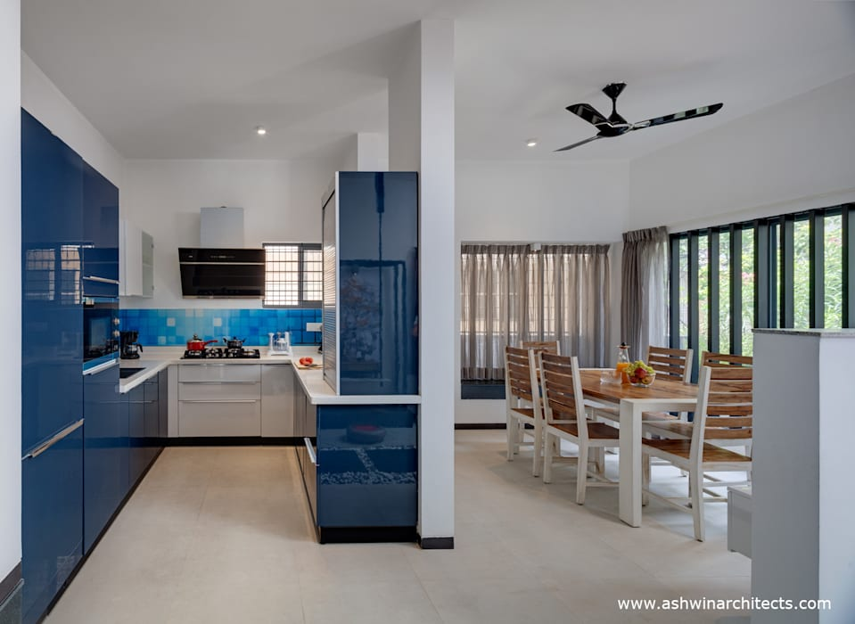 Project: Tree By The House - Interior Design - Kitchen:  Kitchen by Ashwin Architects In Bangalore,Modern
