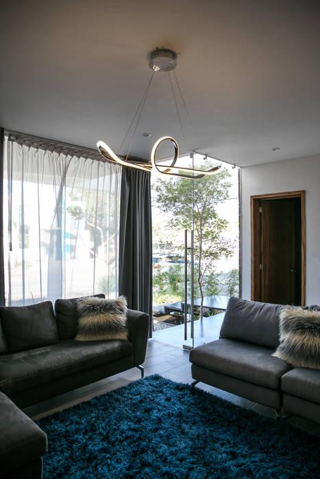 Salones de estilo minimalista de 21arquitectos Minimalista