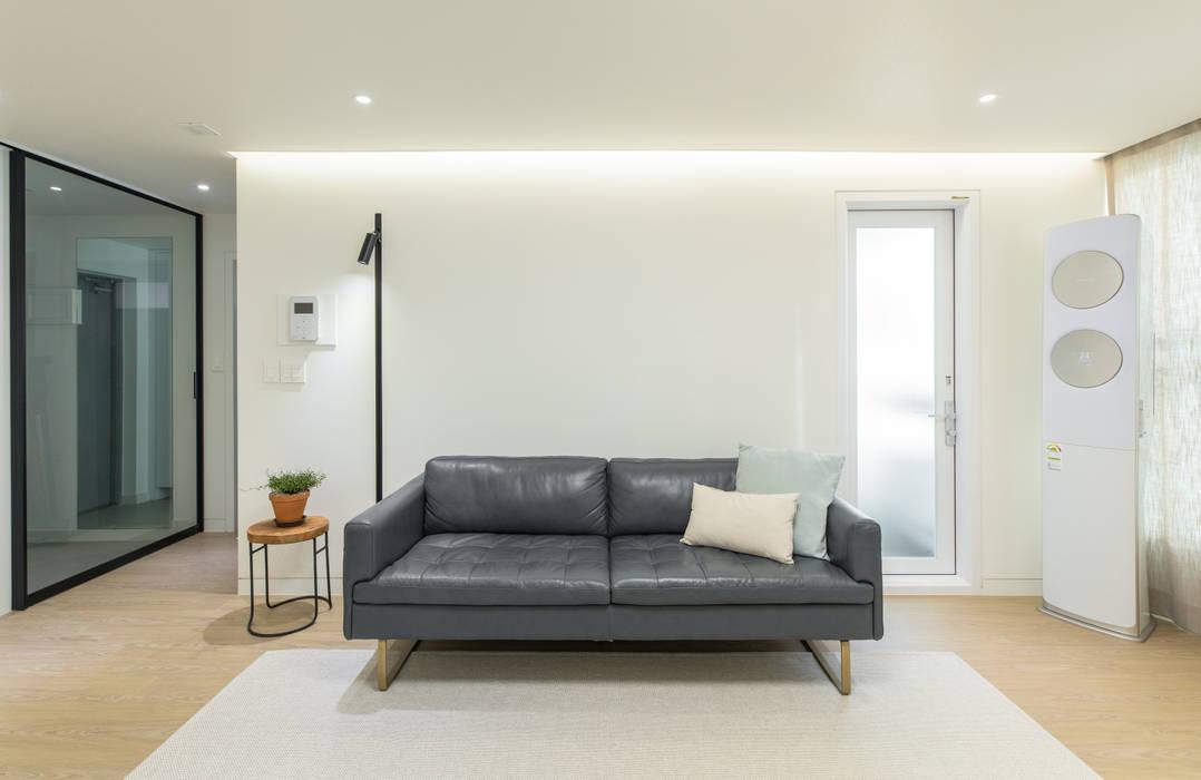 Salas / recibidores de estilo  por 모아디랩,