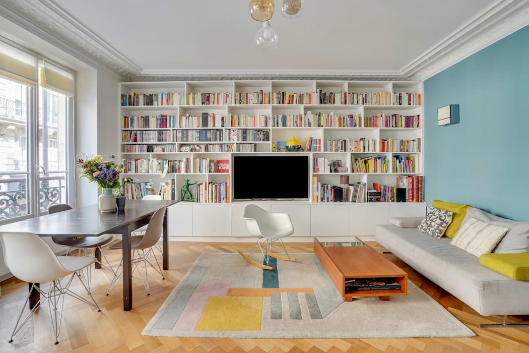 bibliothèque: Salle à manger de style  par Agence KP, Moderne