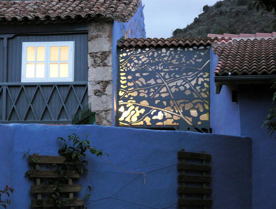Conexión / Pasarela recubierta con piel de DSol Studio de Arquitectura + Arte Rústico Piedra