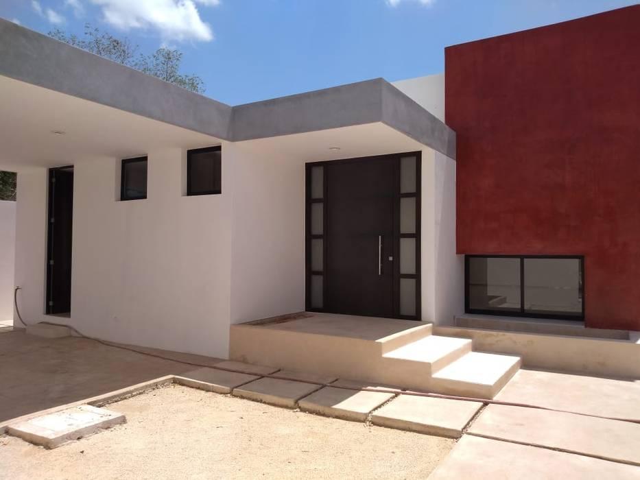 acceso: Puertas de madera de estilo  por Estudio Torrado,