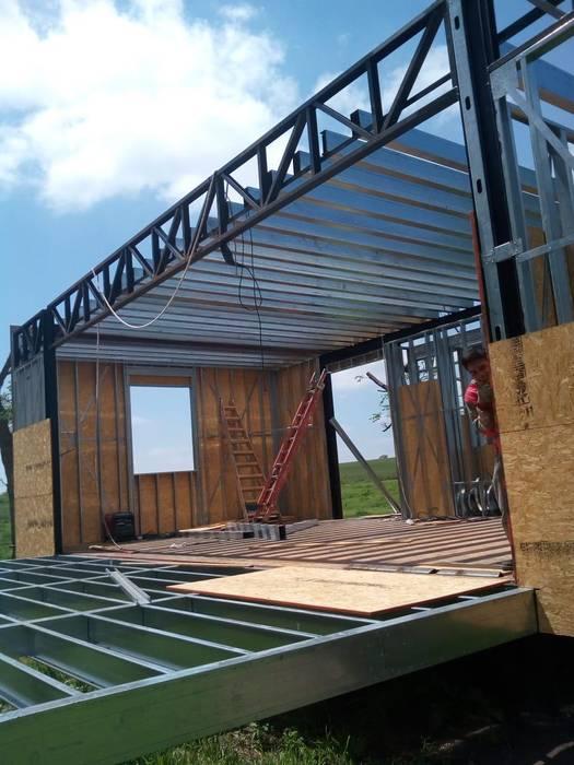 Steel Framing: Casas prefabricadas de estilo  por Ferrocenter,