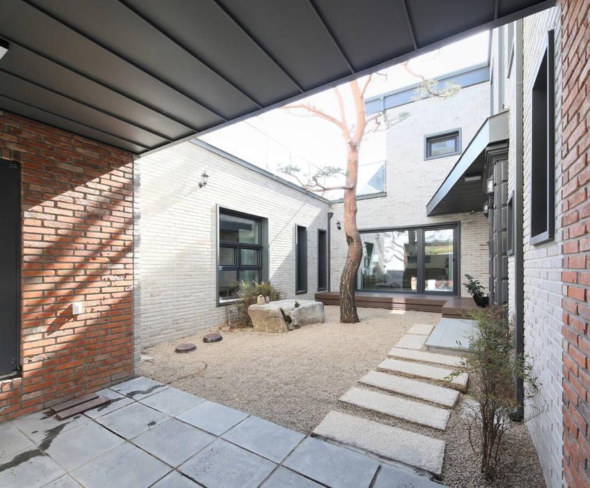 por 주택설계전문 디자인그룹 홈스타일토토 Moderno Pedra