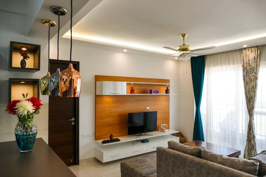 Living Area with floating TV cabinet Modern living room by HomeLane.com Modern