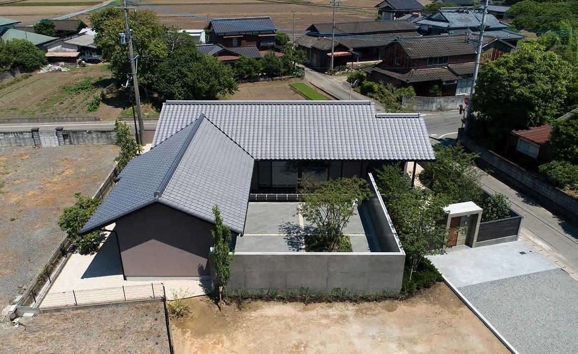 Casas de estilo asiático de Atelier Square Asiático Concreto