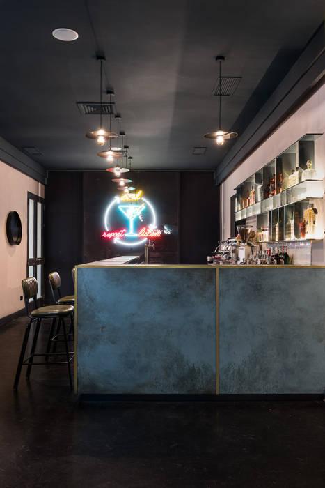 Casa del Jazz - Bo.Bo Bistrot: Sala da pranzo in stile  di Grippo + Murzi Architetti,