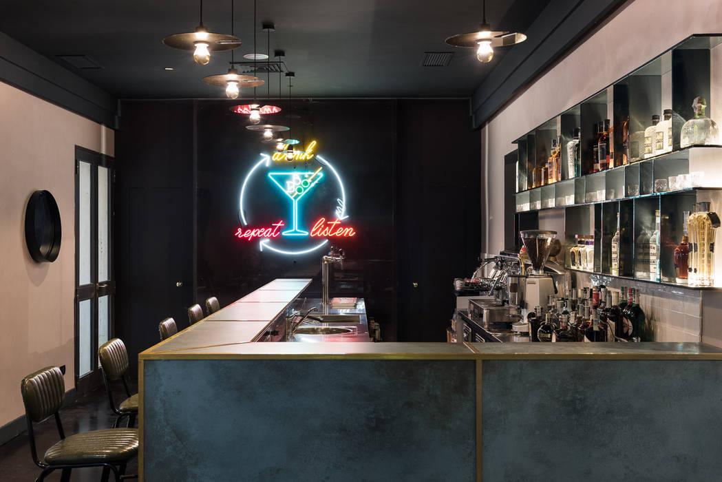 Casa del Jazz - Bo.Bo Bistrot: Sala da pranzo in stile  di Grippo + Murzi Architetti, Moderno