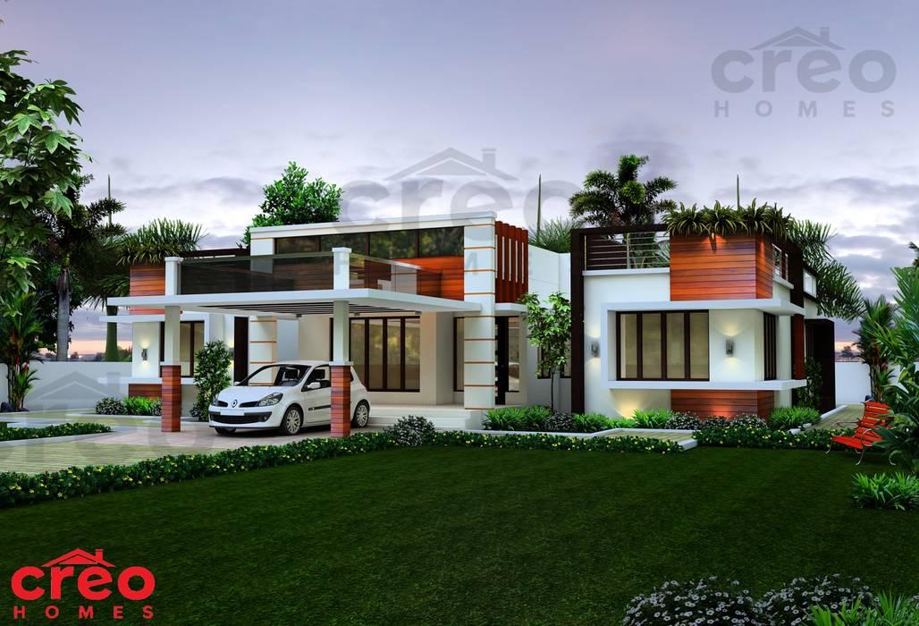 Casas unifamiliares de estilo  por CreoHomes Pvt Ltd, Asiático