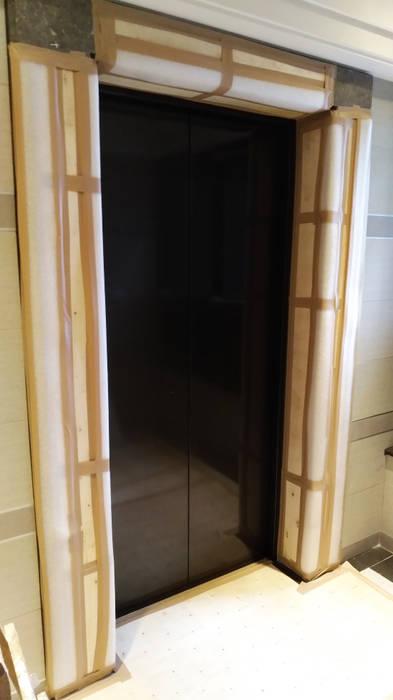 門框保護工程:  地板 by 大吉利室內裝修設計工程有限公司, 隨意取材風