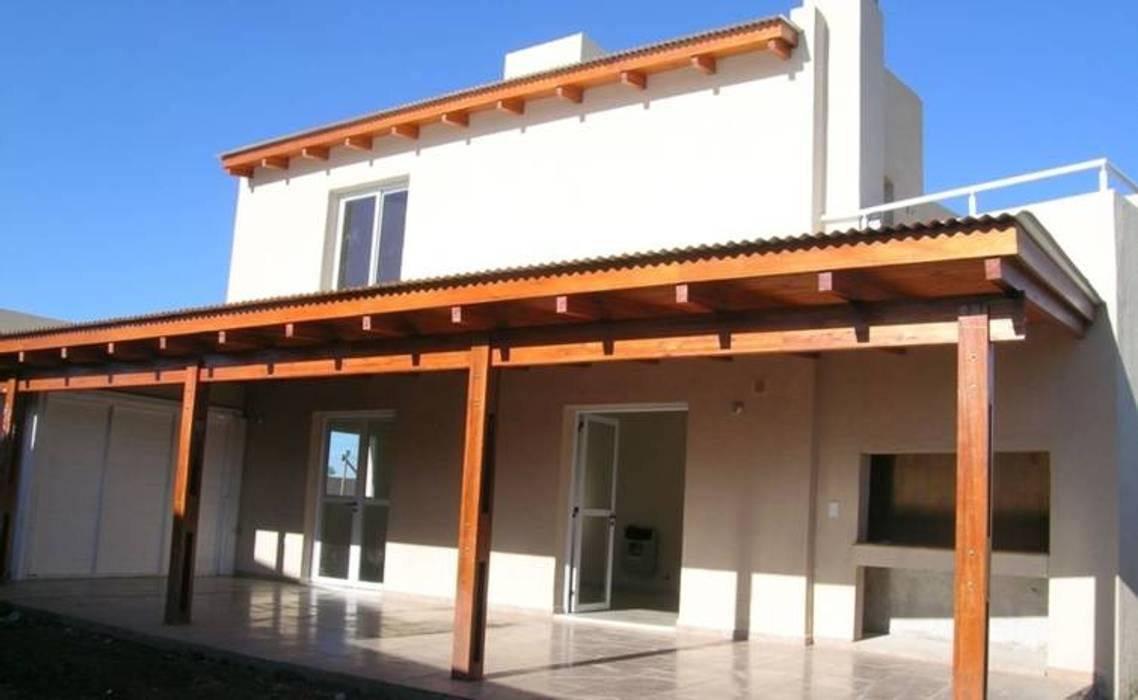 Rojas Guri Arquitectos Nhà cho nhiều gia đình Gạch Beige