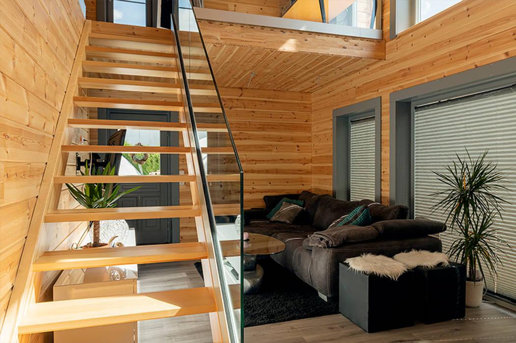 Wohnzimmer - KUBU:  Wohnzimmer von THULE Blockhaus GmbH - Ihr Fertigbausatz für ein Holzhaus,Ausgefallen Holz Holznachbildung