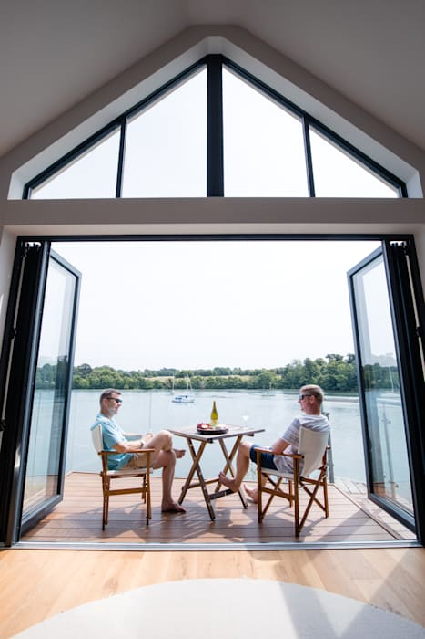 View of balcony, high-level window and bi-folding doors Ruang Keluarga Modern Oleh dwell design Modern