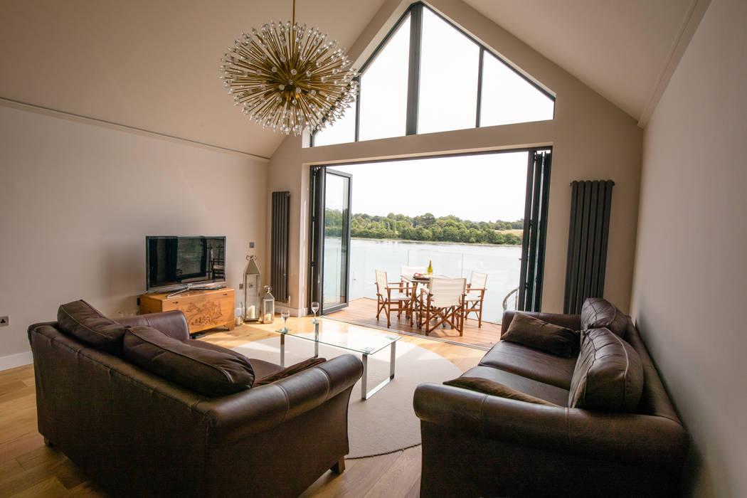 View of open-plan living space Ruang Keluarga Modern Oleh dwell design Modern