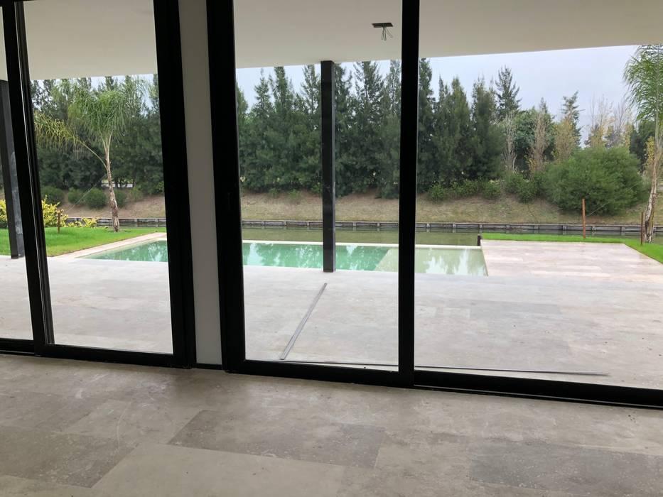 Future House Livings modernos: Ideas, imágenes y decoración de Maximiliano Lago Arquitectura - Estudio Azteca Moderno