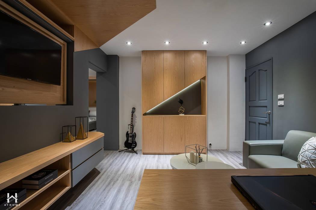 房間起居室:  小臥室 by 在家空間設計, 現代風 實木 Multicolored