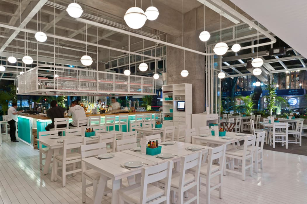 Tropical style gastronomy by Monolito Construcciones Tropical