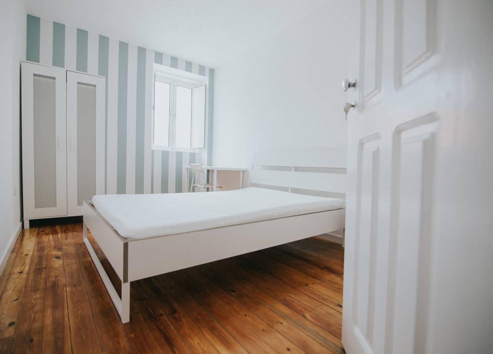 Dormitorios de estilo  por Grupo Prummo , Moderno
