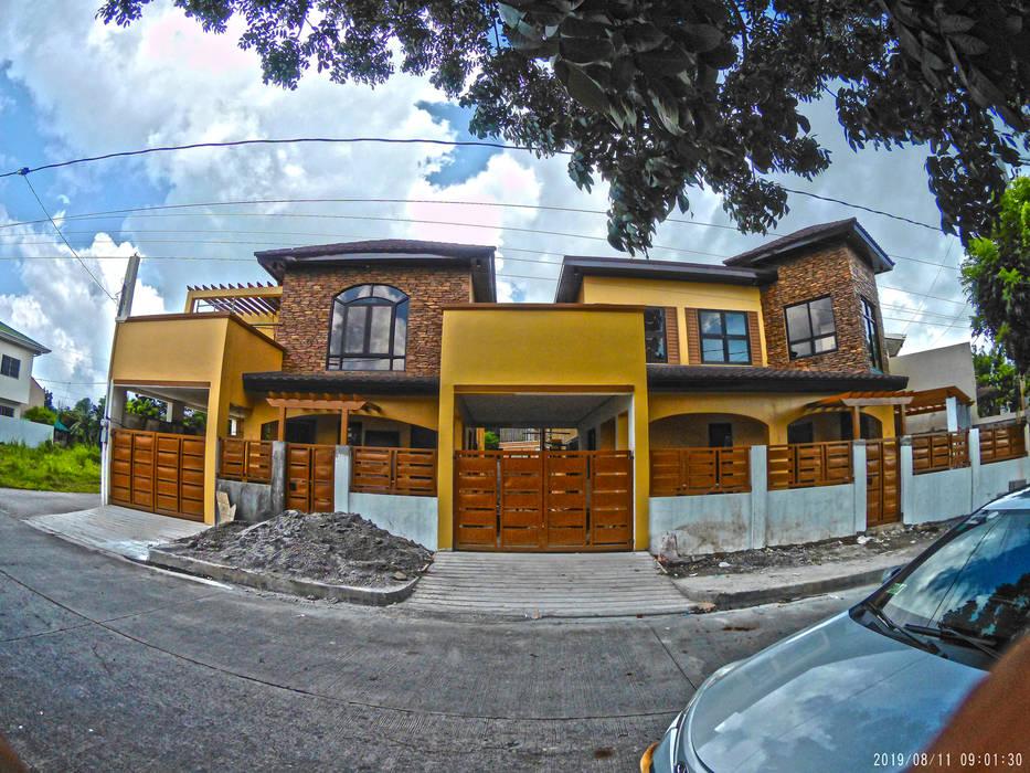 Two Storey Residences at Rosario Cavite ACTUAL PHOTO:  Multi-Family house by MG Architecture Design Studio, Mediterranean Concrete