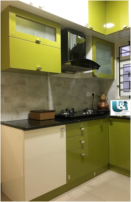 A functional kitchen: modern  by U and I Designs,Modern