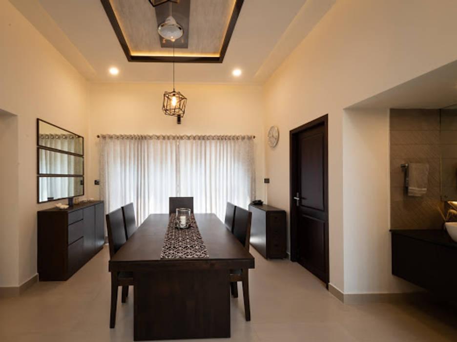 Residence interiors in kozhikode Minimalist dining room by Vidya Anand Design & Decor Minimalist Plywood