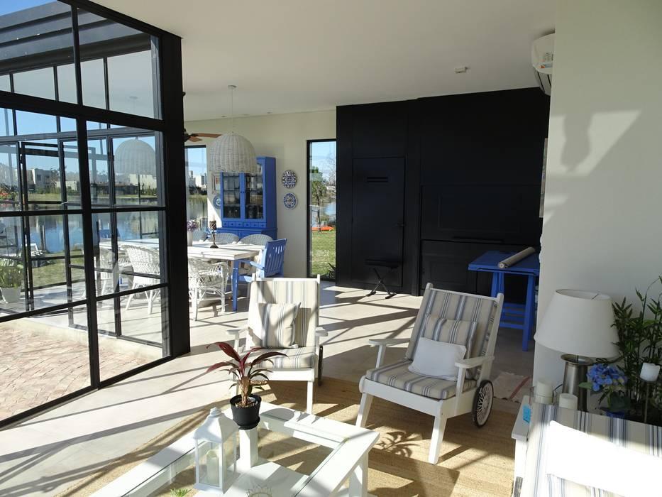 Jardin de invierno con parrilla Jardines de invierno clásicos de Estudio Dillon Terzaghi Arquitectura - Pilar Clásico