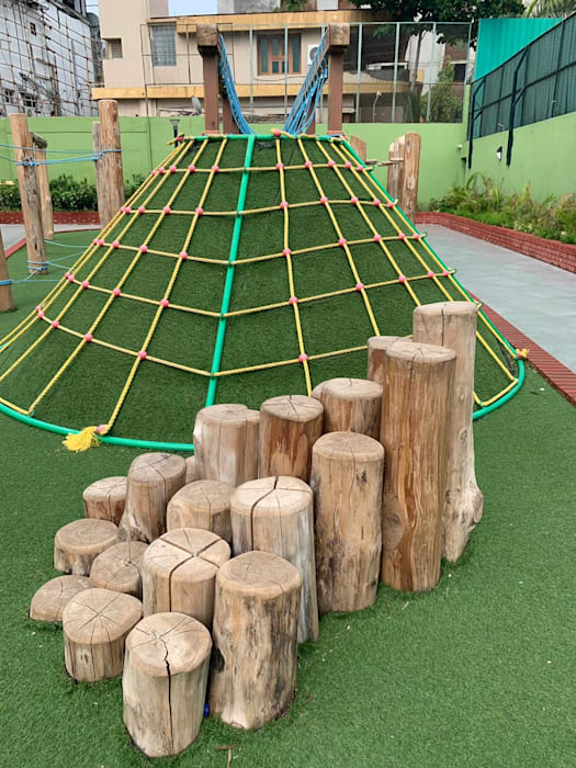 COMBINATION OF LANDSCAPE AND PLAYSCAPE:  Front yard by Monoceros Interarch Solutions,Modern Bamboo Green