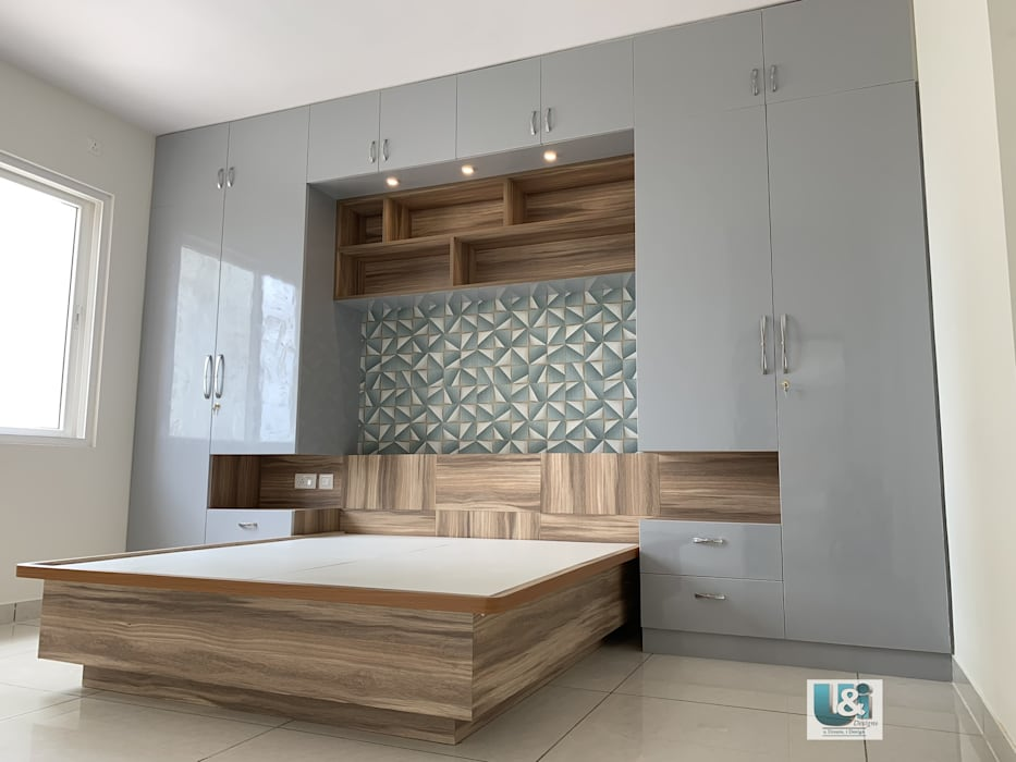 Wardrobe framing the Bed in the Master Bedroom Modern style bedroom by U and I Designs Modern