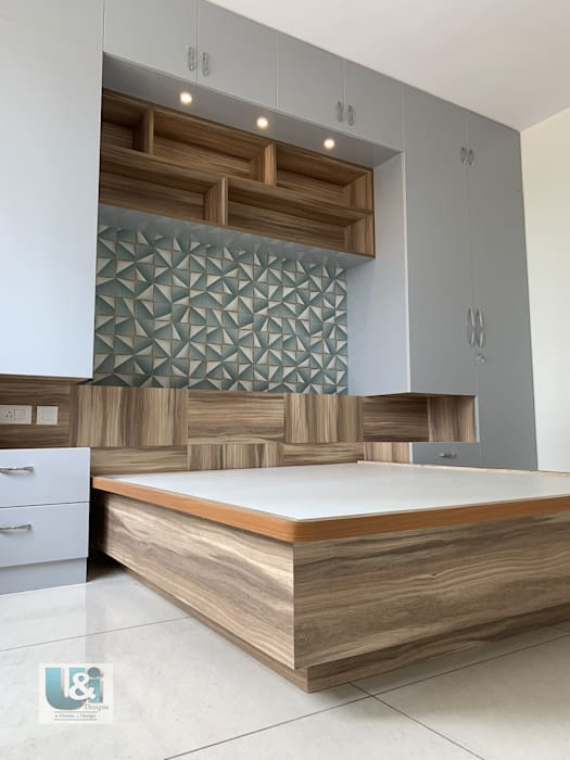 Wardrobe framing the Bed in the Master Bedroom: modern  by U and I Designs,Modern