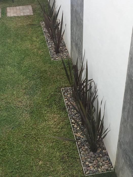 Casa Hércules Jardines modernos de GARAY ARQUITECTOS Moderno
