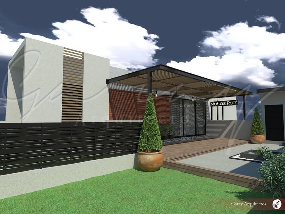 Departamento y Roof Garden Balcones y terrazas modernos de GARAY ARQUITECTOS Moderno