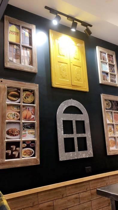 Cafe Wall Classic style walls & floors by Vishakha Chawla Interiors Classic
