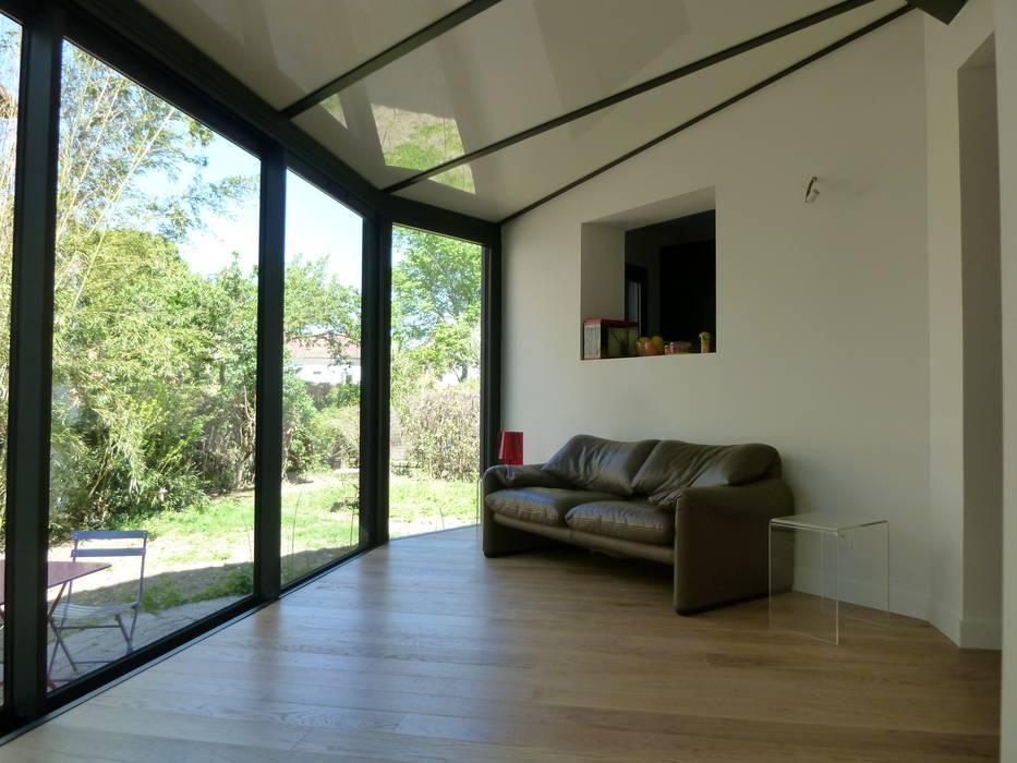 Véranda Salon moderne par FARACHE CLAUDE Moderne