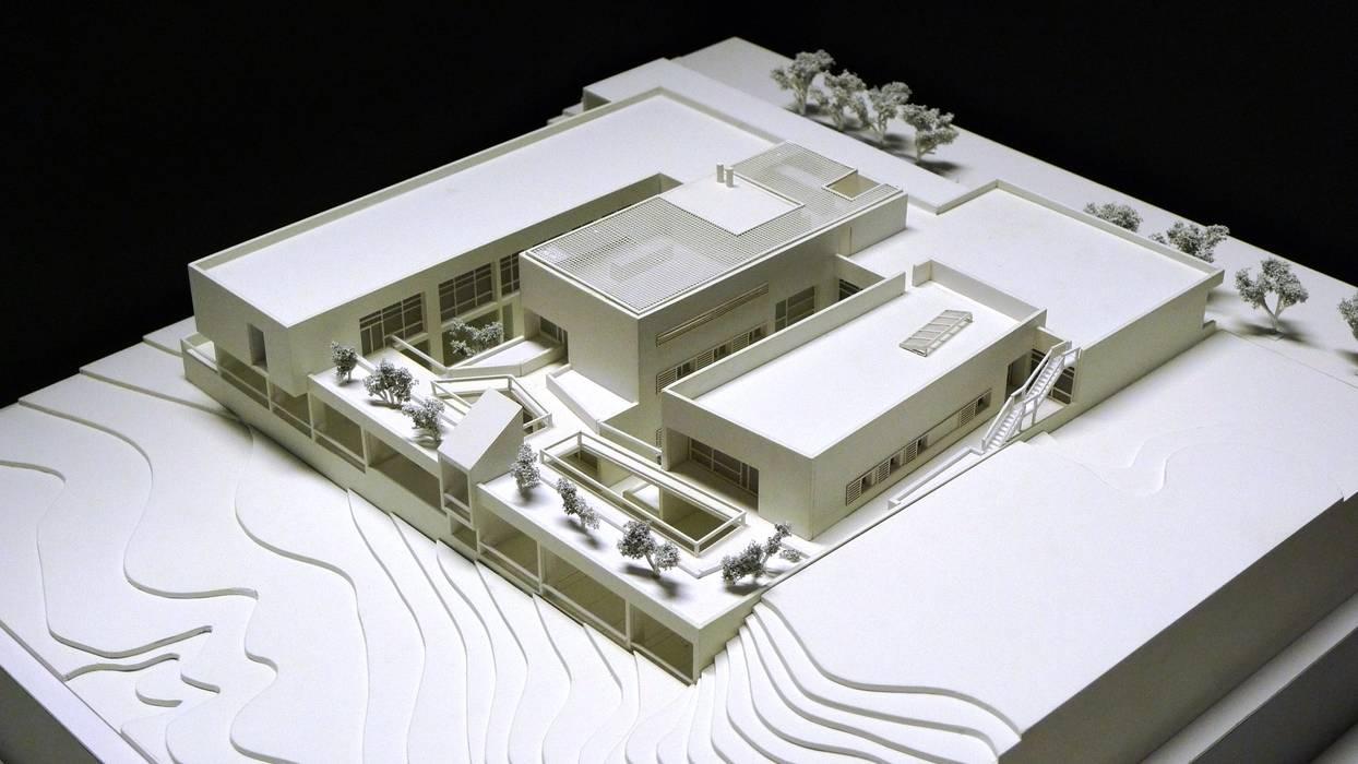 Vista Este Paredes y suelos de estilo moderno de ag arquitectura sa Moderno Ladrillos